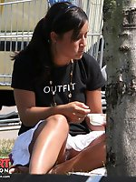 Upskirt pictures - Brunette in white skirt is sitting, up skirt flashing