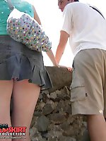 12 pictures - Upskirt shots, of teen blonde cutie in pleated mini