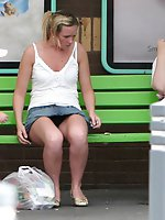 12 pictures - Upskirt sitting - blonde in mini at the bus stop