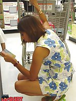 Upskirt pictures - Prudent chick spyed in a shop. Upshorts looking up skirts
