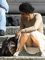 Upskirt pictures - Upskirt of a squatting ebony beauty. Squat upskirt