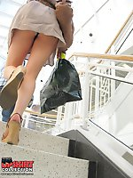 24 pictures - The real upskirt - voyeur blonde in public place