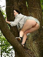 15 pictures - Doll in skirt climbs up the tree and has her cunt bared