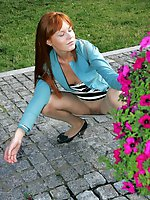 Upskirt pictures - Sweet coed in striped dress sits on hunkers and shows cunt